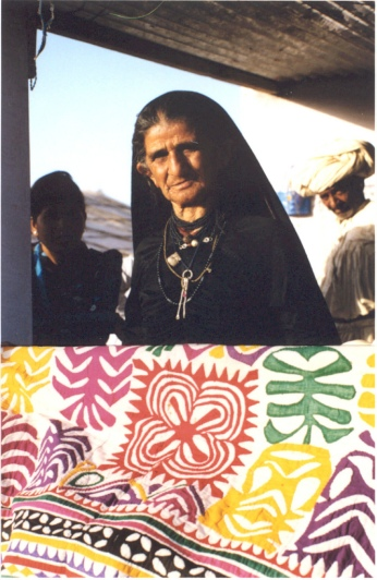 A Vaghadia Rabari woman with her appliqued quilt.